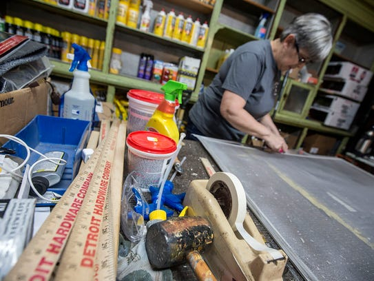 Co-owner Anna Sparkman, 61, fixes screens at the Detroit