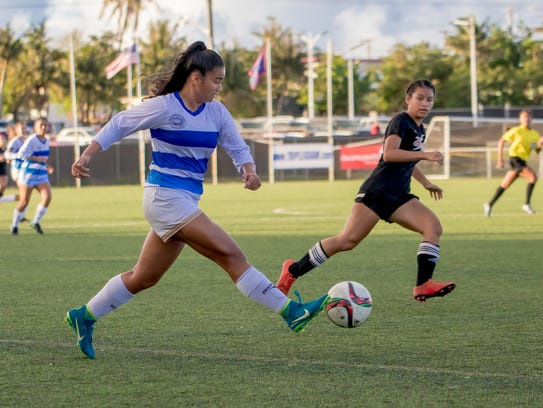 Notre Dame High School player dribbles the ball toward