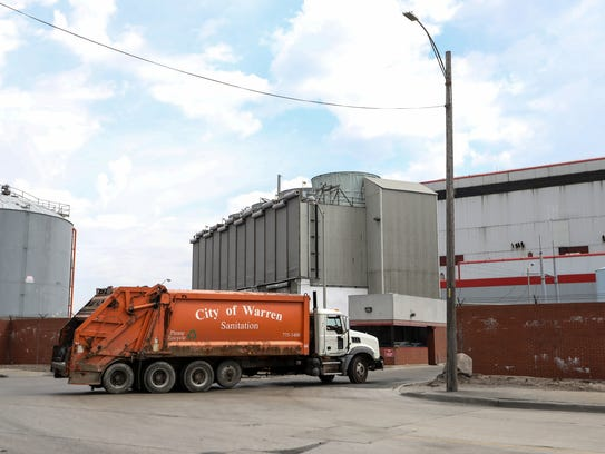 A City of Warren garbage truck drives into the Detroit