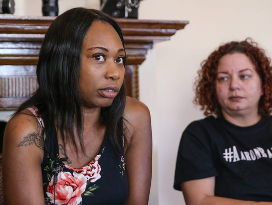 From left, Erica Bailey, daughter of Aaron Bailey,