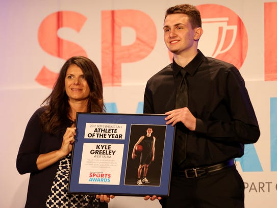 West Salem's Kyle Greeley accepts his award for Boys