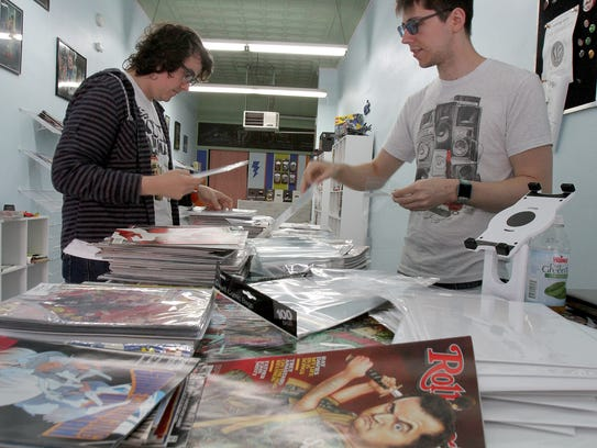Doug Preston (left) and his brother Justin are shown at their soon-to-open 'The Geekery Comics' on Matawan's Main Street.