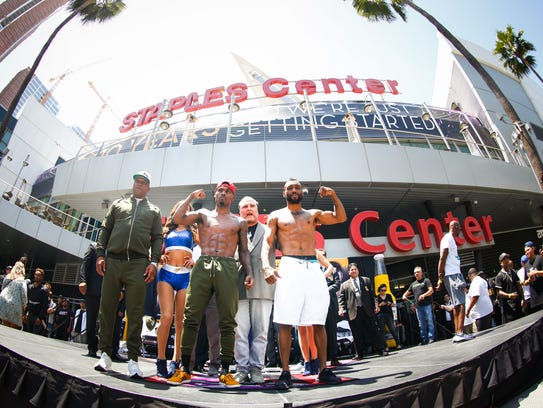 Austin Trout, right, and Jermell Charlo pose for photographers