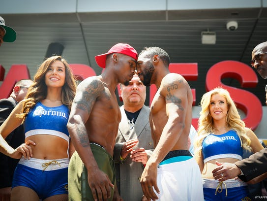 Austin Trout, right, and Jermell Charlo get forehead