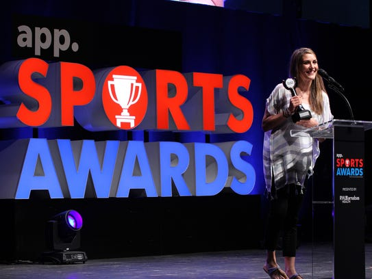 Manasquan basketball coach Lisa Kukoda accepts the