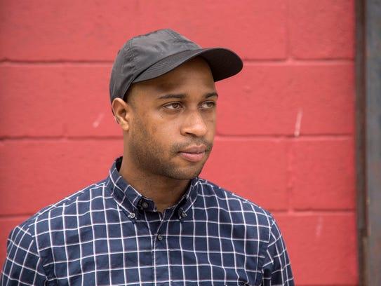 Detroit artist Marlo Broughton poses for a photo near