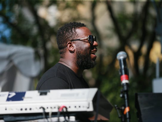 Robert Glasper performs on the piano with  2017 Featured