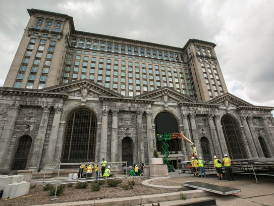 Workers set up for the upcoming train station party