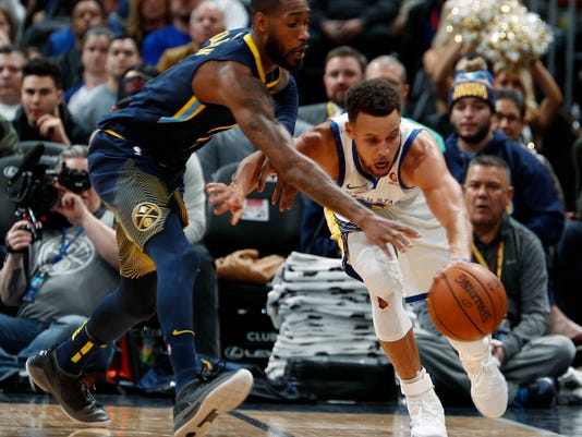 Denver Nuggets guard Will Barton, left, reaches for the ball next to Golden State Warriors guard Stephen Curry during the second half of an NBA basketball game Saturday, Feb. 3, 2018, in Denver. The Nuggets won 115-108. (AP Photo/David Zalubowski)