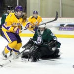 Elmira College senior forward Ashton Hogan goes to the net against William Smith College goalie Maggie Salmon during Friday's game at Murray Athletic Center. Hogan produced four goals and three assists in two games against William Smith and was named the ECAC West Player of the Week.