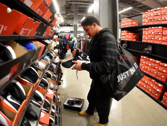 Mohsen Mohamed, 15, of Dearborn shops for shoes at