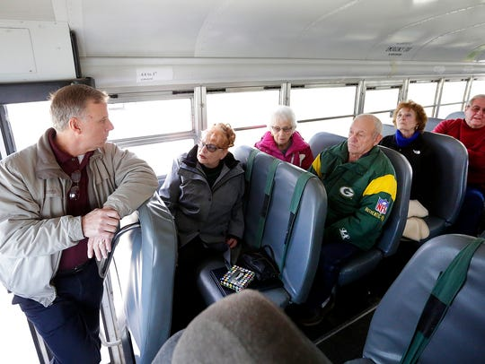 Fond du Lac County Sheriff Mick Fink addresses Eldorado residents Gale Degner, Betty and Donald Nitschke, Marlene Wittchow and Orville Batterman as they take a bus to the Washington County Courthouse in January, 2016, to express their concern over the placement of a sex offender in their village.