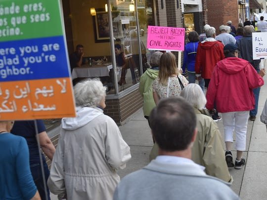 Organized by Invisible Door County, about 75 anti-racism marchers walked North Third Avenue sidewalks in Sturgeon Bay in support of Charlottesville counter protesters.