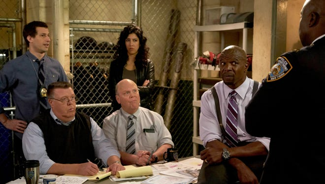 Stephanie Beatriz, center, plays one of three female characters in the nine-person core ensemble of Fox's 'Brooklyn Nine-Nine.'
