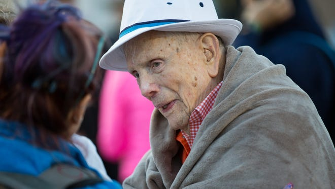 Ben Skardon, 100, a Bataan survivor, talks and laughs with those around him on Sunday March 25, 2018, during the Bataan Memorial Death March at White Sands Missile Range.