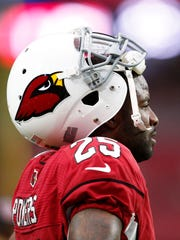 Arizona Cardinals Jerraud Powers takes a break against