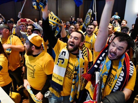 Members of The Roadies, a Nashville SC supporter group, yell, chant and scream Major League Soccer officials name Nashville the new MLS expansion team.
