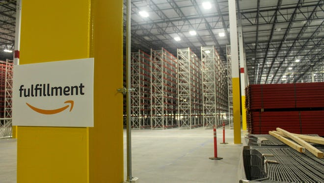 Shelves in the distance at the Amazon fulfillment center in Livonia. Come this fall, those shelves will be stocked with merchandise.
