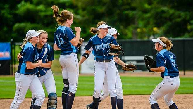 Members of the Richmond softball team celebrate after 4-2 defeat of Escanaba in their Division 2 state semifinal game Thursday, June 15, 2017, at Seccia Stadium in East Lansing.