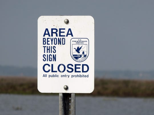 These signs were posted recently to discourage the continued use of man-made channels created by vessels accessing the refuge. Generally, boats are not prohibited in navigable waters within the refuge.