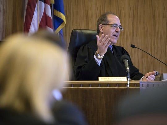 Chief Judge John H. Guthmann speaks during a motion