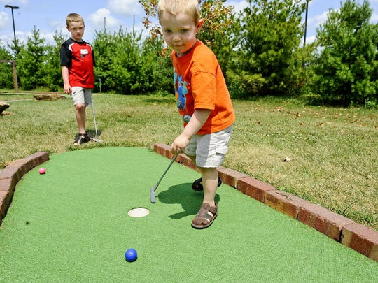 Enjoy mini golfing.