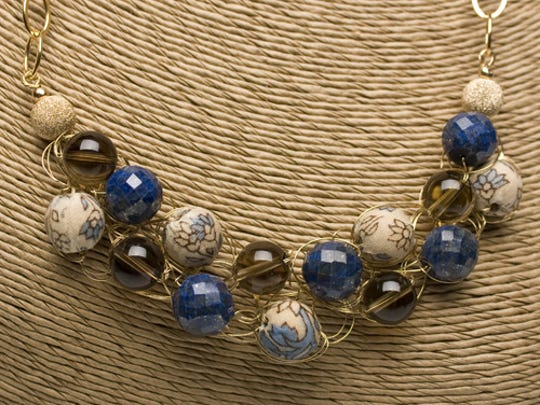"""Necklace by Angela Lensch, whose gallery is a site on the """"Women Walking on Water"""" art crawl in Egg Harbor."""
