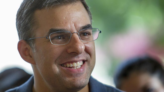 In this Aug. 21, 2019, file photo U.S. Rep. Justin Amash, I-Cascade Township, holds a constituent meeting in Grand Rapids. Amash of Michigan, a former Republican who was the lone GOP lawmaker to support the impeachment of President Donald Trump, is officially not running for reelection.