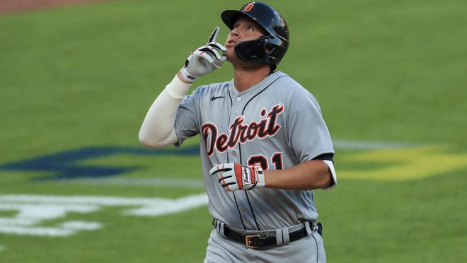Detroit Tigers' JaCoby Jones reacts after hitting a two-run home run in the ninth inning during a baseball game against the Cincinnati Reds at Great American Ballpark in Cincinnati, Saturday, July 25, 2020.