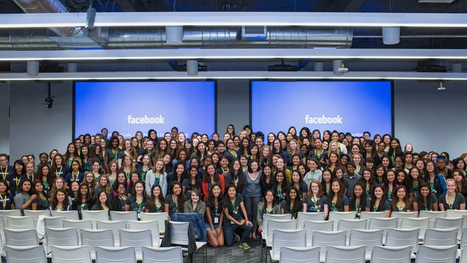 Facebook Chief Operating Officer Sheryl Sandberg poses with teens taking part in Girls Who Code this summer.