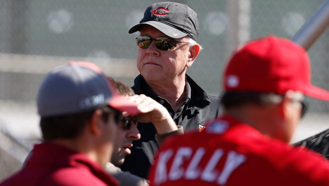Reds general manager Walt Jocketty watches the action from behind a batting cage during practice at spring training in Goodyear.