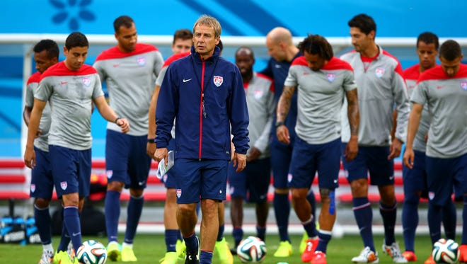 USA head coach Jurgen Klinsmann (center) with his team during training at Arena Amazonia.