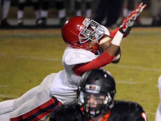 Brentwood Academy defensive back Trent Taylor (1) blocks