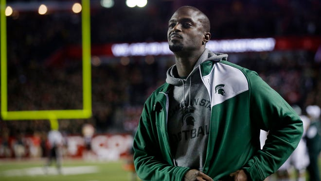Plaxico Burress, who played college football at Michigan State, stands on the sideline during a game against Rutgers on Oct. 10, 2015, in Piscataway, N.J.