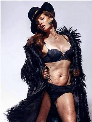 A photo from Marie Claire photo shoot from December 2013, shows Cindy Crawford before photos are re-touched.