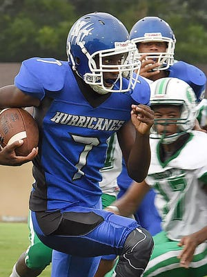 North Central running back Ju'Wan Milburn heads around end on Friday during the St. Landry Parish Jamboree at Donald Gardner Stadium. The Hurricanes and the Eunice junior varsity team ended the game at 6 points apiece.