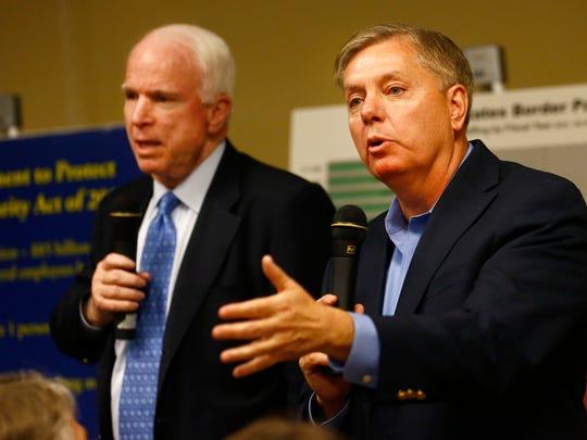 Sens. Lindsey Graham, R-S.C., right, and John McCain, R-Ariz.
