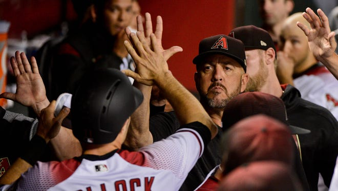Apr 5, 2017: Arizona Diamondbacks center fielder A.J. Pollock (11) celebrates with teammates after scoring in the third inning against the San Francisco Giants at Chase Field.