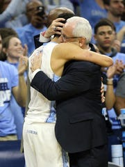 Mar 27, 2016; Philadelphia, PA, USA; North Carolina Tar Heels head coach Roy Williams (center) celebrates with guard Marcus Paige (5) after defeating the Notre Dame Fighting Irish in the championship game in the East regional of the NCAA Tournament at Wells Fargo Center. Carolina won 88-74.