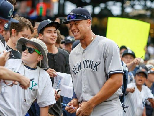 New York Yankees right fielder Aaron Judge (99) signs