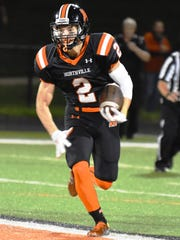 Northville's Andrew Hezemy carries the ball in Friday's