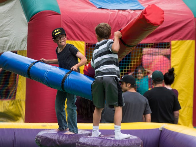 Children play during the Funtime Inflatables fundraiser