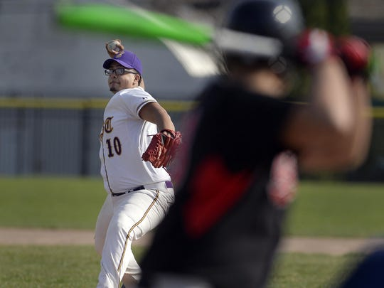 East's Joel Alicea winds up a pitch during a regular