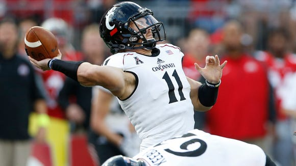 UC's Gunner Kiel launches a touchdown pass to Chris Moore against Ohio State on Sept. 27.