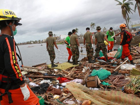 Military personnel and members of the Philippine's Special Reaction Unit search for the bodies of victims of Typhoon Haiyan on Nov. 12, 2013.