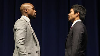 Superstar Manny Pacquiao and Floyd Mayweather attend a Red Carpet press conference Wednesday at the Nokia Theatre in Los Angeles for their upcoming 12-round welterweight world championship unification mega-fight.