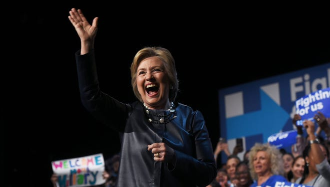 Hillary Clinton waves during a campaign rally at the Apollo Theatre in New York on March 30, 2016.