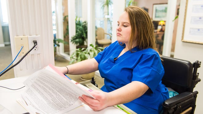 Lexi Harrison works on the computer during her internship at Dr. Plack's dentist office on Monday, April 11 in Snow Hill.