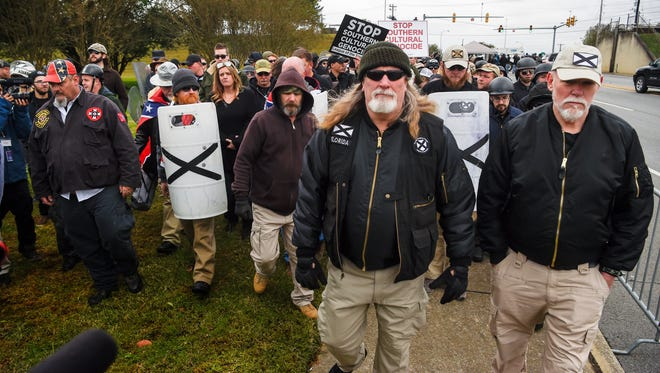 Protesters march to the checkpoint for a White Lives Matter rally in Shelbyville, Tenn., on Saturday, Oct. 28, 2017.