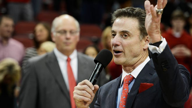 Rick Pitino addresses the crowd after winning his 700th game.
